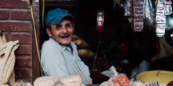 man smiling in market